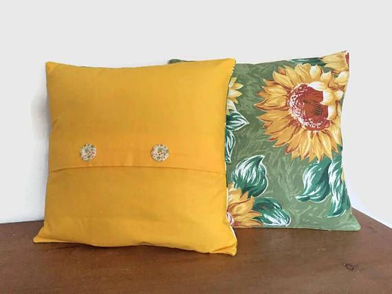 This lovely Vintage Style, Sunflower fabric has been given a new lease of life with a sunny yellow back and flower button finish. These Mid-Century Modern Retro style cushions would be perfect as conservatory cushions or garden cushions. They are lovely accent cushions in a Retro style home.  I have 2 of these each with slightly different pattern placement - as shown in the pictures above  They measure 14 by 14 (36cms by 36cms)  The have an envelope style closure on the back with flower…