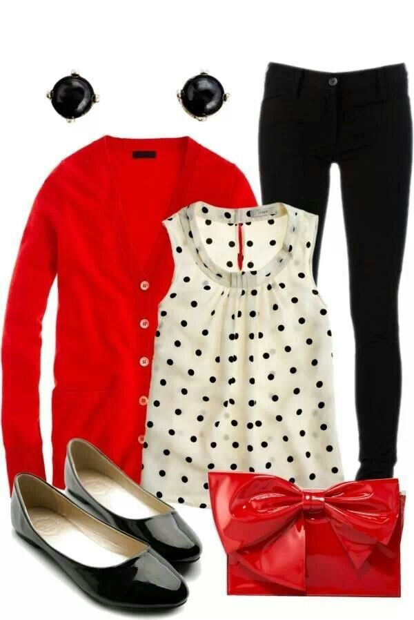 Black pants with black and white polka dot blouse. Red cardigan and black flats.
