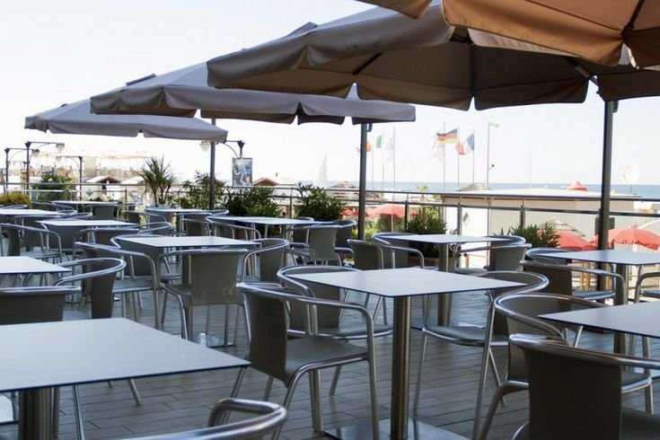 Mare chairs with upholstered seats at Hotel Excelsion
