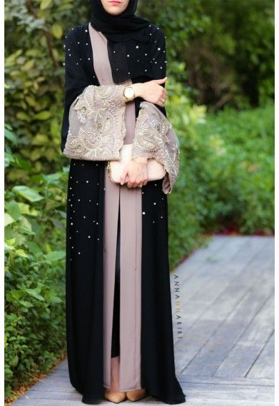 It's a beautiful abaya. Not sure about that lace work on the sleeves
