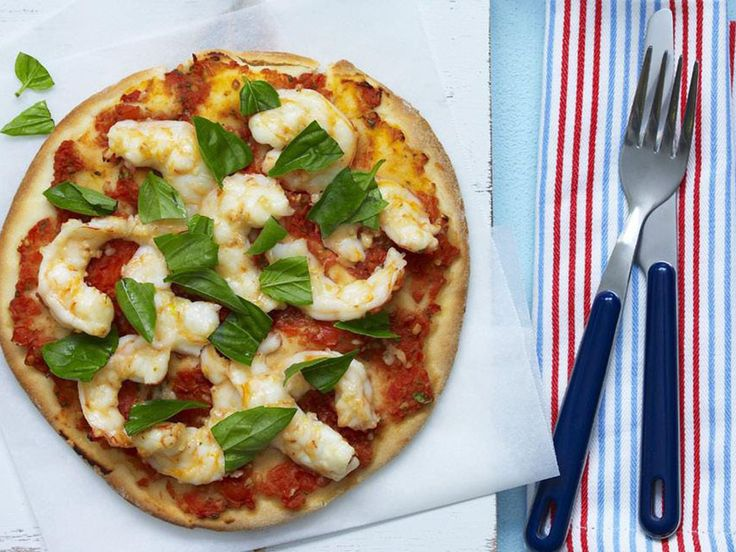 Spicy and redolent with garlic, these chilli prawn pizzas are a crowd-pleaser. You can add some torn buffalo mozzarella if you like, and the finished pizzas are great topped with baby rocket tossed in olive oil and lemon juice.