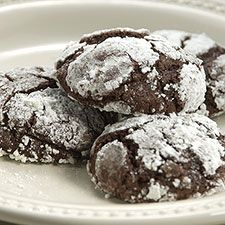 "Chocolate crinkle cookies. Kinda brownie-esque. I used the King Arthur Whole Grain version which is slightly different than this. It called for cooled coffee and I used my iced coffee half and half with soy milk. It called for spelt flour but I used KA White Whole Wheat flour. The recipe said they were fragile but I wanted to give them away, so I put the dough in muffin papers and baked them like ""mookies"" (muffin cookies). Turned out great."