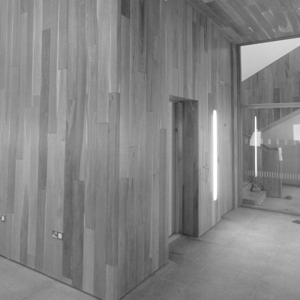 . The timber element folds to become a ceiling and walls creating a gallery exhibition space on the southern end