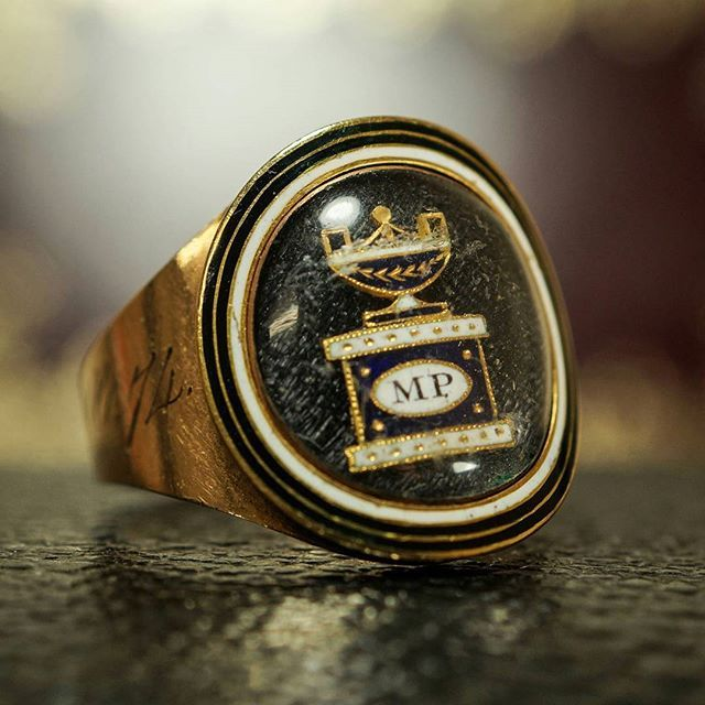 """Georgian memorial ring dedicated to Mary Page, and later William Page. The inscription to the back of the head reads: """"Mary Page, ob 5th July 1807 AET 61"""". There is a later added inscription to the outer band, presumably commemorating her husband: """"William Page, ob 8th Dec 1816 AET 74""""."""