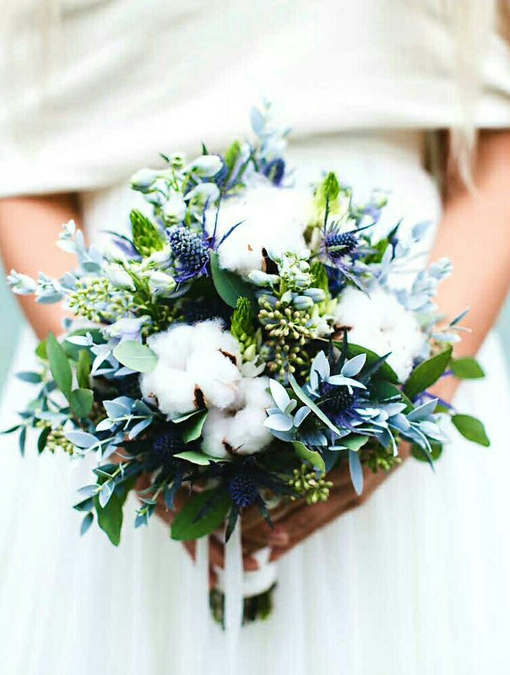 Beautiful Wedding Bouquet Showcasing: Blue Eryngium Thistle, Light Blue Delphinium, Star Of Bethlehem, Raw White Cotton, Green Seeded Eucalyptus + Several Additional Varieties Of Greenery & Foliage