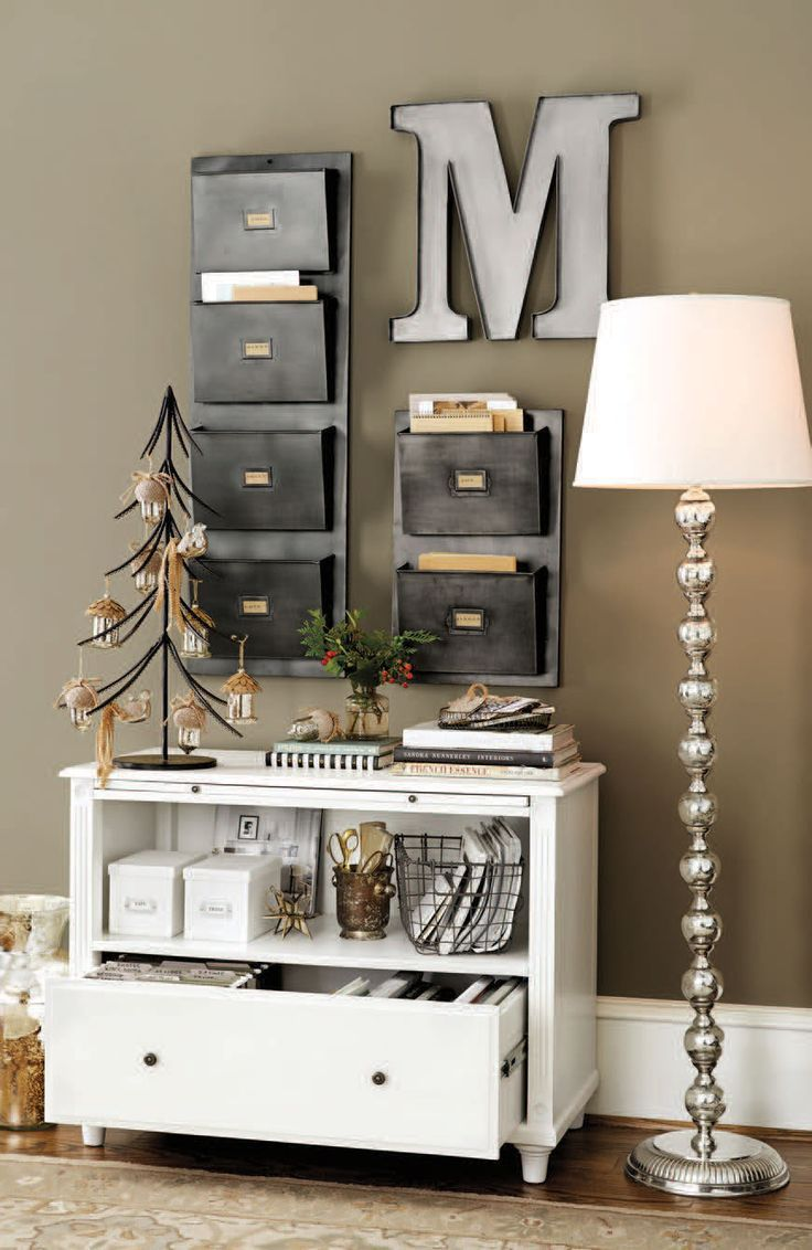 A bookshelf, file storage, and wall pockets turn a small sliver of wall into a hardworking storage system.