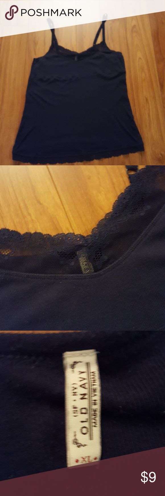 XL OLD NAVY CAMI IN NAVY BLUE WITH LACE This XL Old Navy navy blue camo had lace across the bodice. Stretchy and pretty! Great under your newest fall additions. Smoke free home . Washed in cold water and hung up to dry.  In really great condition. Old Navy Tops Camisoles
