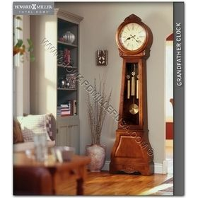 610-900 Howard Miller Floor Grandfather Clock This French and Scandinavian inspired grandfather clock features light distressing and a beautifully detailed, removable crown and shell overlays. The aged dial features distinctive Roman numerals beneath a convex glass crystal.