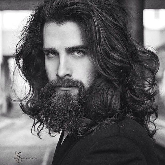 My man has long hair, something like Luca Sguazzini's, just more curly & black
