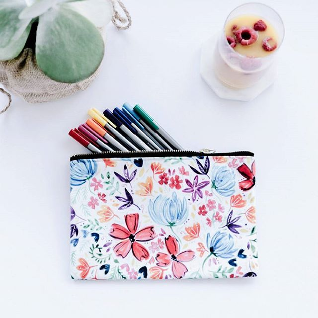 You can never have too much pretty stationery. Especially when you can match it with cute colorful pens :D These pouches are also great for storing washi tape and planner stickers (or so my sister tells me and she owns roughly a billion pencil cases and notebooks)  Check out more pouch designs in my store! The designs are all hand painted by me then printed on the fabric :-) The texture of the paint comes up so well it looks like they've been painted directly on! . . . #stationerylove…