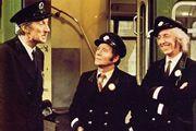 On The Buses. Image shows from L to R: Inspector Blake (Stephen Lewis), Stan Butler (Reg Varney), Jack Harper (Bob Grant). Image credit: London Weekend Television.