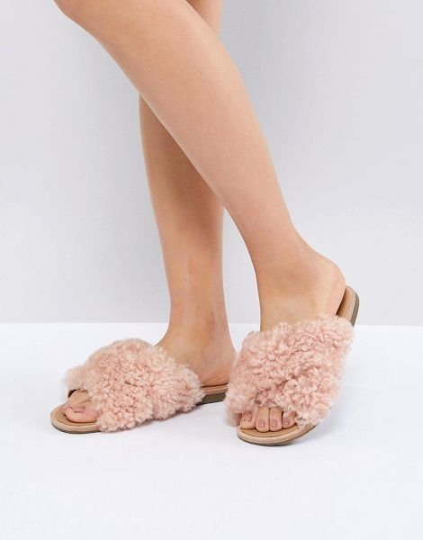 19dcf79e1 Joni Pink Shaggy Cross Strap Slides by Ugg. Sandals by UGG, Faux-fur