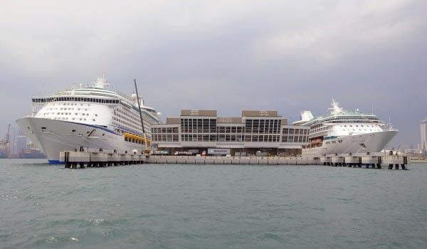Royal Caribbean's Legend of the Seas and Voyager of the Seas berthed side-by-side for the first time in Singapore.