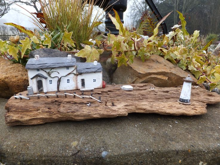 """""""Burry View Cottage"""", Gower.  Handmade in Wales and set on driftwood found on Llangennith Beach, Gower.  Made using reclaimed materials and Welsh Slate and dried heather."""
