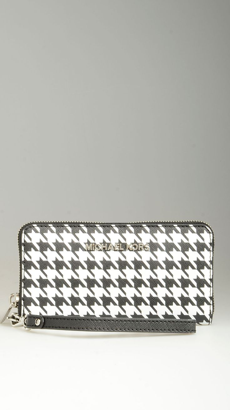 Houndstooth Saffiano leather purse featuring zip fastening, two card slots, a zippered coin pocket, a phone case, two notes compartments, an open pocket, removable wriststrap, silver hardware, 6.6'' x 0.7'' x 3.5'', 100% Saffiano leather .