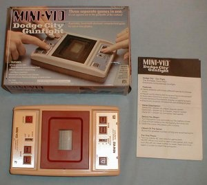 Mego Mini-Vid Dodge City Gunfight (1979, VFD Video Game Console) Model# 97003.  $49.95 shipped @ http://bygone-binds.ecrater.com/p/15189209/mego-mini-vid-dodge-city#: Handheld Electronics, Video Game Console, Vintage Handheld, Handheld Games, Video Games, Vintage Electronics, Vfd Video, Minivid Vintage