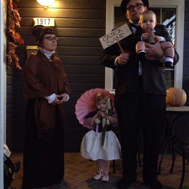 Haunted Mansion Family Halloween costumes stretching portrait family so awesome!