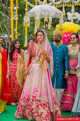 Bridal Lehengas - Ombre Pink Lehenga | WedMeGood | Pink Ombre Embroidered Lehenga with a Red Choli  #wedmegood #indianbride #indianwedding #lehenga #pink #ombre #bridal #bridalentry