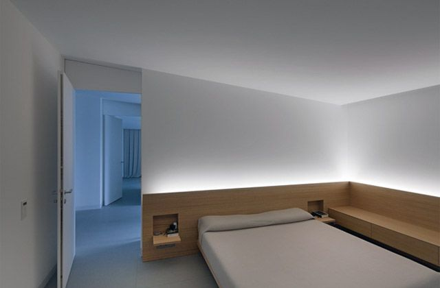 Beautifully lit bedroom inside the Casa delle Bottere by British architect John Pawson. Photo by Marco Zana.