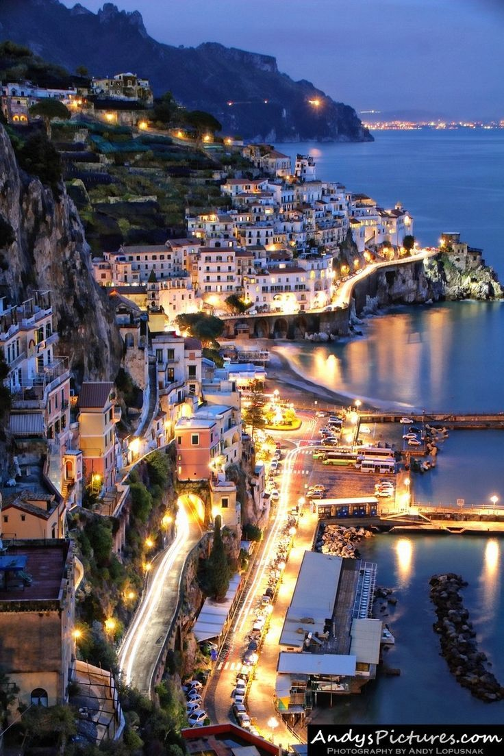 Amalfi by night, Italy. Amalfi Coast Italy  The Amalfi Coast is a 43 mile stretch of coastline on the southern coast of the Sorrentine Peninsula. Vietri sul Mare, Minori, Ravello, Scala, Salerno and Positano are all considered part of the Amalfi Coast.