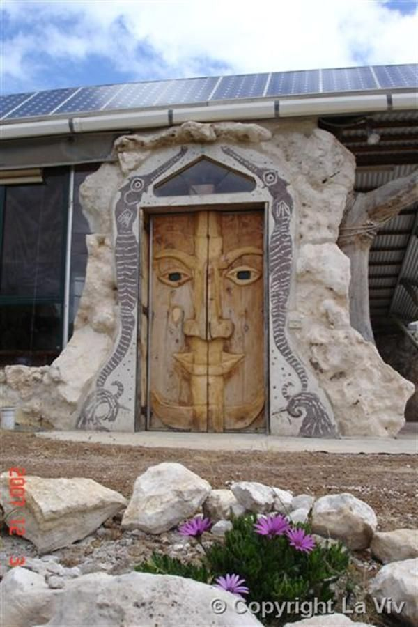 Is This Not A Fun Front Door Unique Frontdoor Was Placed Perfectly Between Two Huge Stones With Carved Wooden Face Intimidating All Visitors