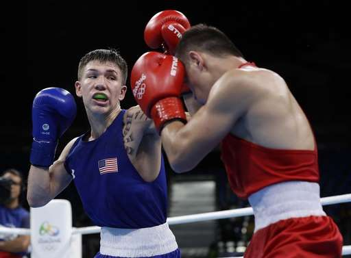 US boxing medal drought ends with Nico Hernandez's bronze:  August 12, 2016  -     United State's Nico Miguel Hernandez, left, fights Uzbekistan's Hasanboy Dusmatov during a men's light flyweight 49-kg semifinals boxing match at the 2016 Summer Olympics in Rio de Janeiro, Brazil, Friday, Aug. 12, 2016. (AP Photo/Frank Franklin II)