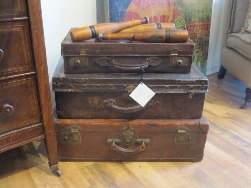 Stacked vintage suitcases and vintage wooden skittles!! A shame we've got the price tag...