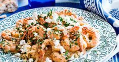 This recipe for shrimps à la spetsiota comes from Estiatoria Milos, a Greek seafood restaurant with branches in Athens, New York, Miami and London. This is a classic, simple dish with the shrimp braised in tomato sauce, feta and oregano. It's super quick to make but is packed full of delicious flavours.