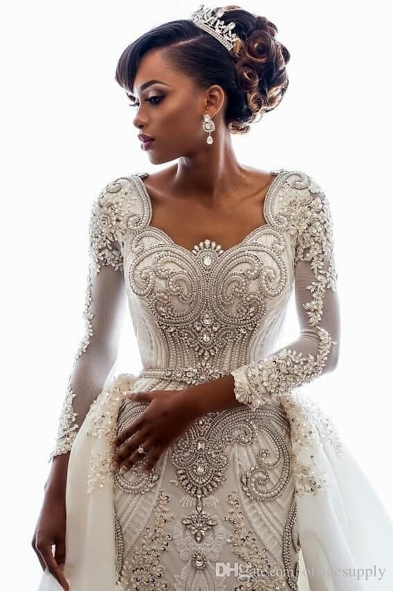 2019 Beading African Wedding ceremony Attire Crystals Overskirts Luxurious Lengthy Sleeves Sheath Removable Prepare Bridal Robes Customized