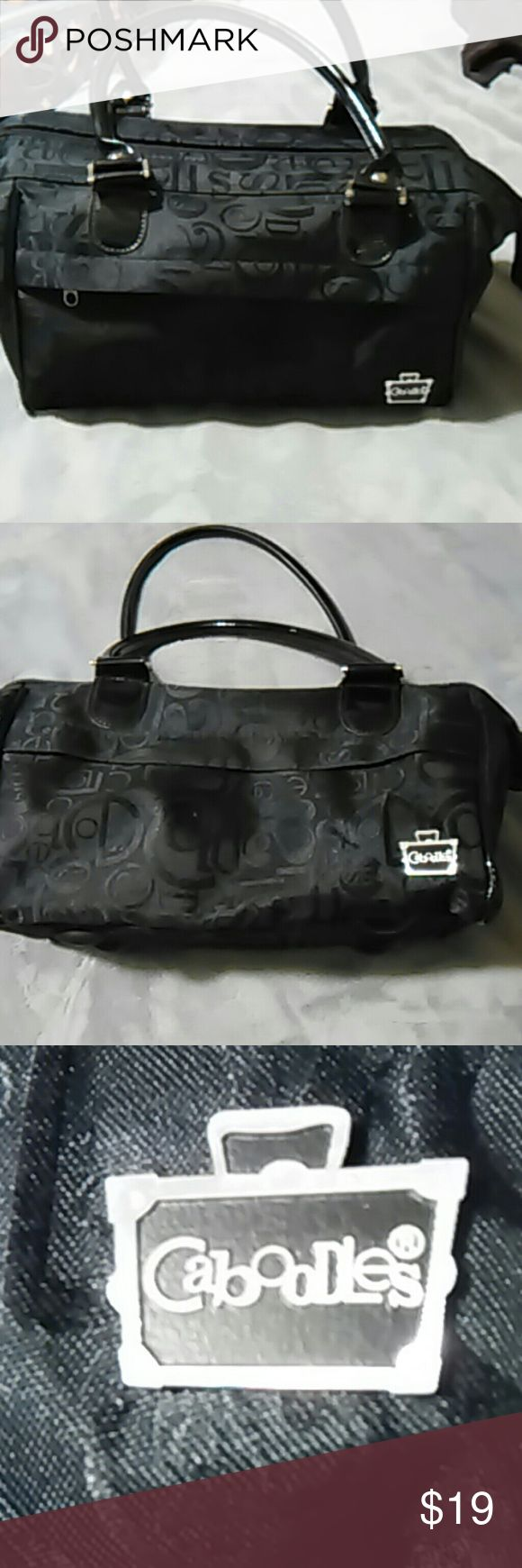 Caboodles signature travel/makeup bag This bag has 2 outside pockets & numerous brush HOLDERS and compartment inside. This bag is in EXCELLENT condition. Please view ALL photos. Thank you for stopping by . Caboodles Bags Cosmetic Bags & Cases