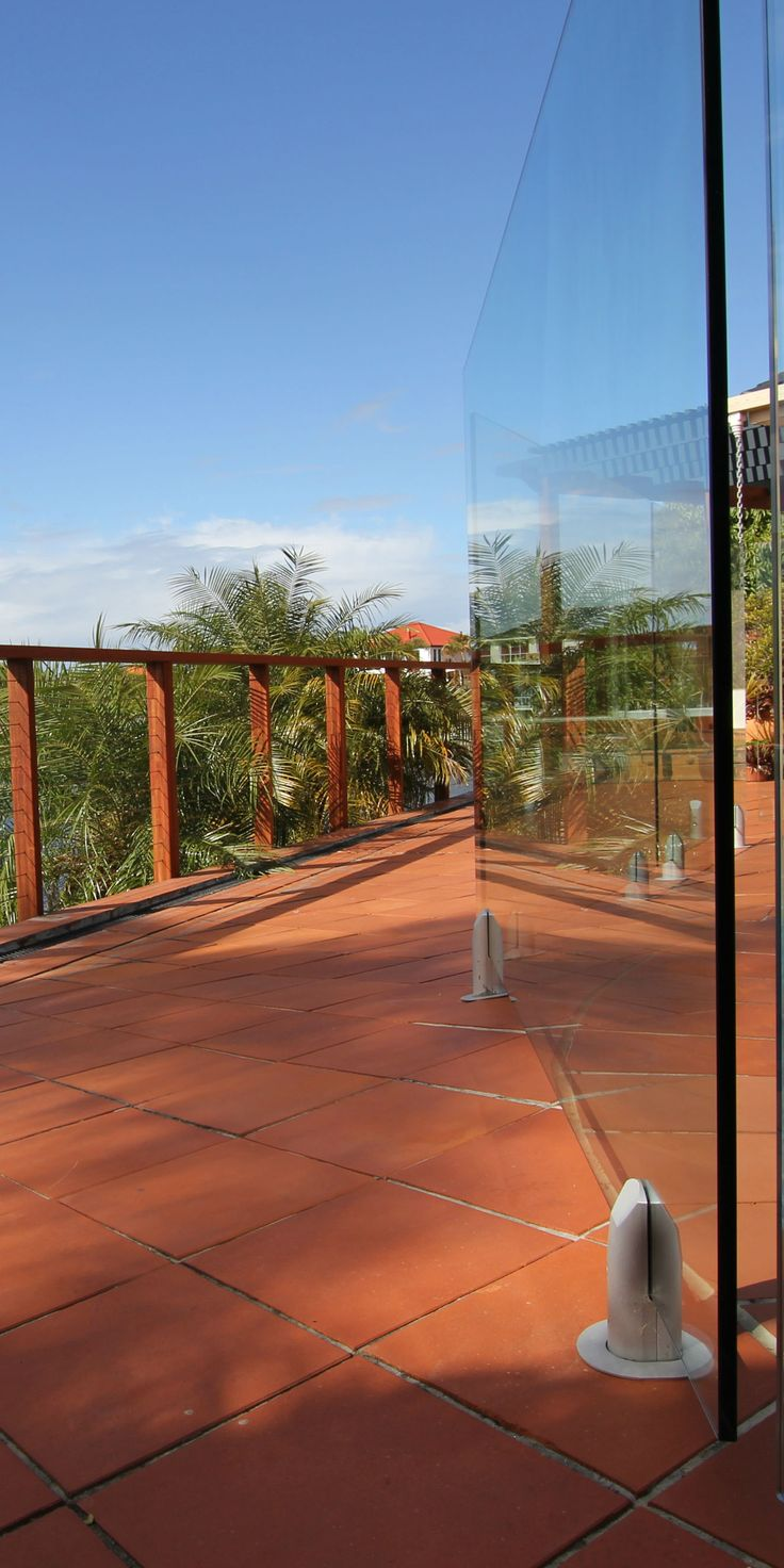 Glass fencing and wire balustrade for pool surround