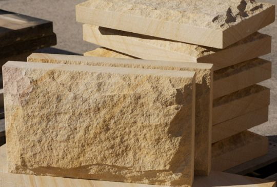 Stonemart, the leading natural stone exporter in india offers offers teak sandstone walling with rock face surface finish for interior and exterior home decor.