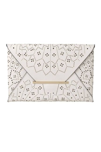 A delicate perforated design perks up the classic envelope clutch - so cute and summery!
