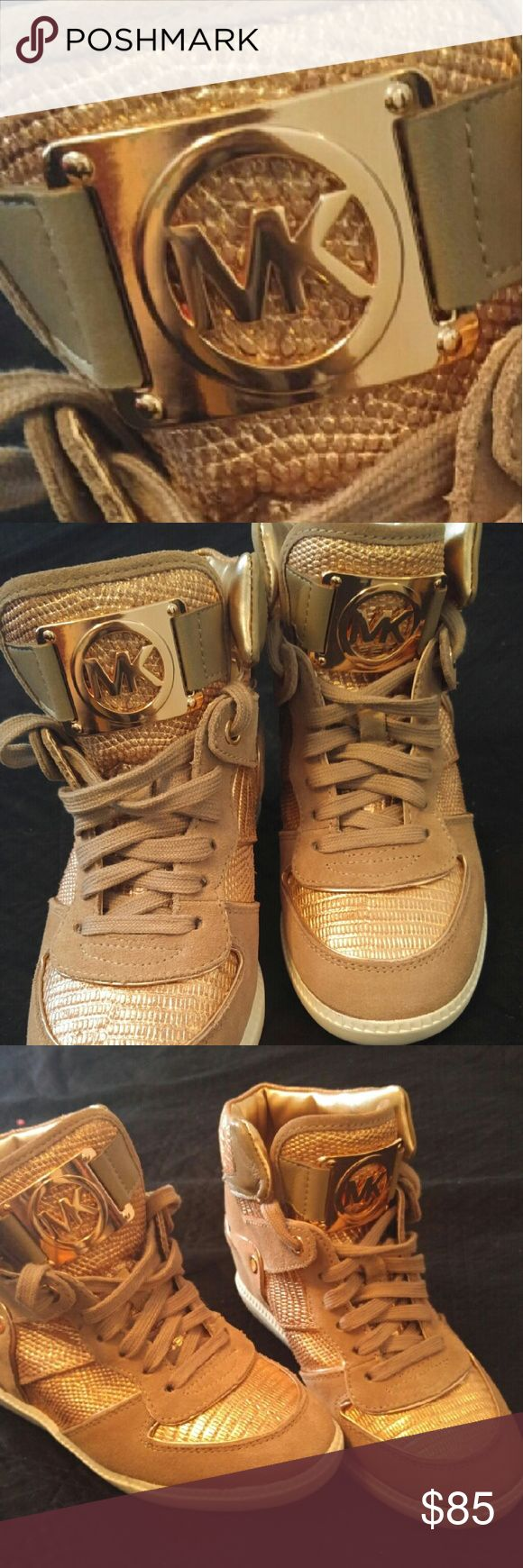 7.5 Michael Kors rose gold high top sneakers Stunning rose gold Michael Kors high top sneakers. These are GORGEOUS. Worn once. Killer with skinny jeans! Getting rid of them because my shoe collection is far too large already and these could be loved more by someone else sadly! Im telling you these shoes are awesome. Michael Kors Shoes Sneakers