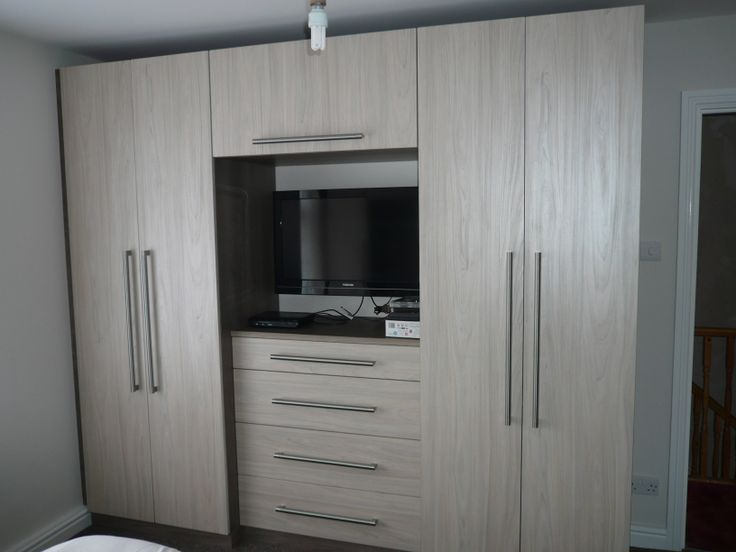 Fitted bedrooms dark swiss elm carcasses with light swiss elm doors and chunky handles!
