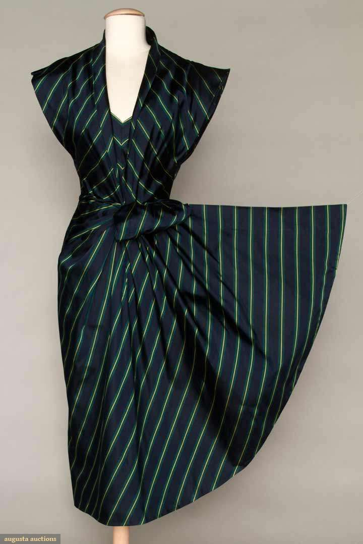 PATULLO-JO COPELAND DRESS, 1940s Dinner dress of ribbed navy, green & yellow striped silk, shawl collar to low V neckline, short double winged sleeves, wrap sarong-style narrow skirt, attached self fabric cord belt, B 36, W 24.5, L 46, excellent.