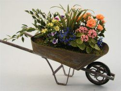 Plants & Wheelbarrow by Carol Wagner.  Great idea for spare plants with no home!