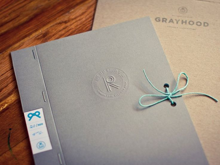 Embossing, tie string closure and an interesting finish to personalise a generic cover for the ribbon type specimen book. Courtesy of Grayhood.
