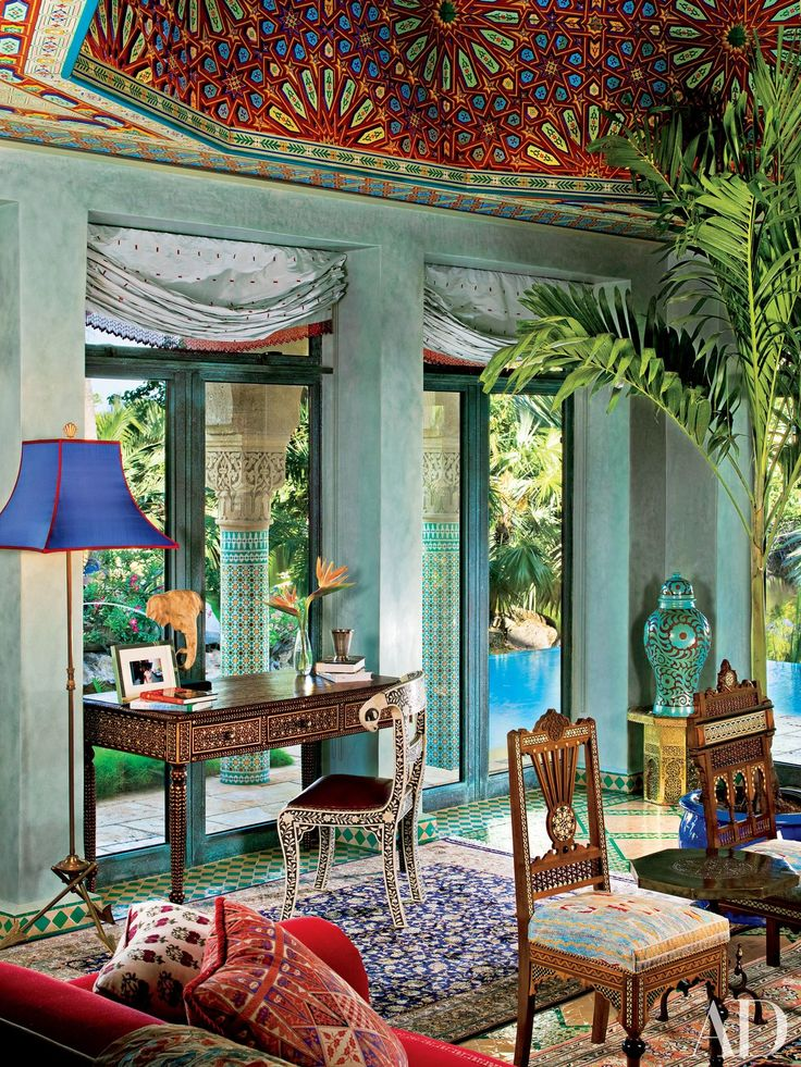 Interior designer Todd Black conceived the bone-inlay desk and chair in the living area of the Key West, Florida, home shared by model, actress, and writer Veronica Webb and her husband, George Robb, and family. The dome ceiling was produced in Morocco.