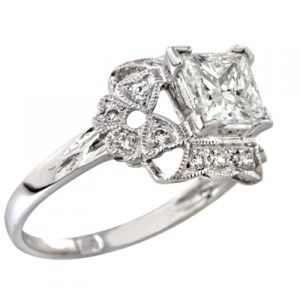 Love the scroll-y detail and square diamond on this antique.