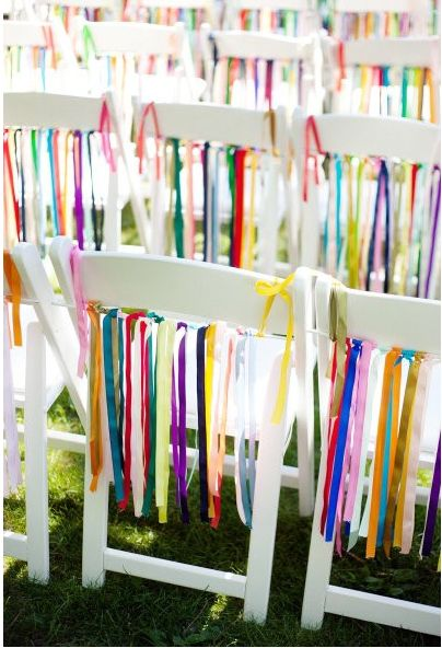 Looking for a way to transform the chairs at your next event???  This idea can work in so many different ways... obviously, for a wedding, but how about your 4th of July party?  Red, White and Blue ribbons - even attach them to those cheap white plastic stacked chairs ... they would be instantly transformed from basic to amazing!  Use for a baby shower in blue and pink.  Imagine how great these would look outside when a breeze blows by.  Stunning!!!