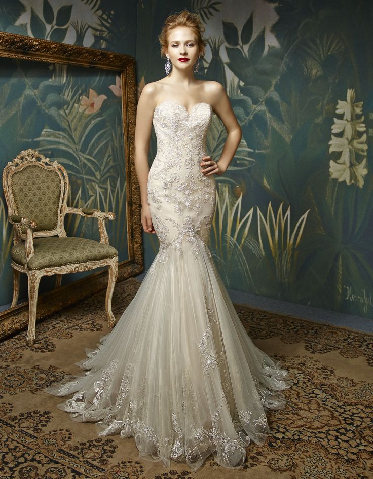 Enzoani bridalwear. Jion design from the Enzoani Blue 2017 collection.  Sweetheart strapless lace crystal and bead detailed dramatic mermaid ivory wedding dress with train.