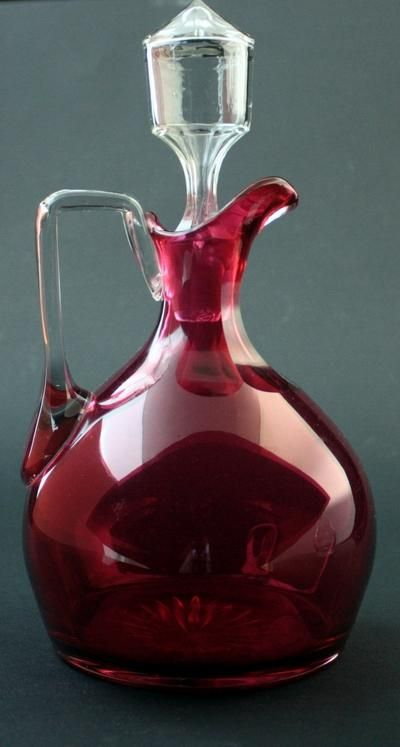 Antique ruby glass jug with clear glass stopper