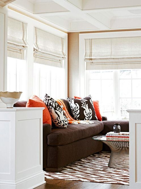 Lighten Up.   A dark brown sofa will not dominate a space when surrounded by lighter elements.  Paint the walls a pale neutral then choose artwork, accessories, and accent furniture in lighter or colorful hues to balance the darkness of the piece.