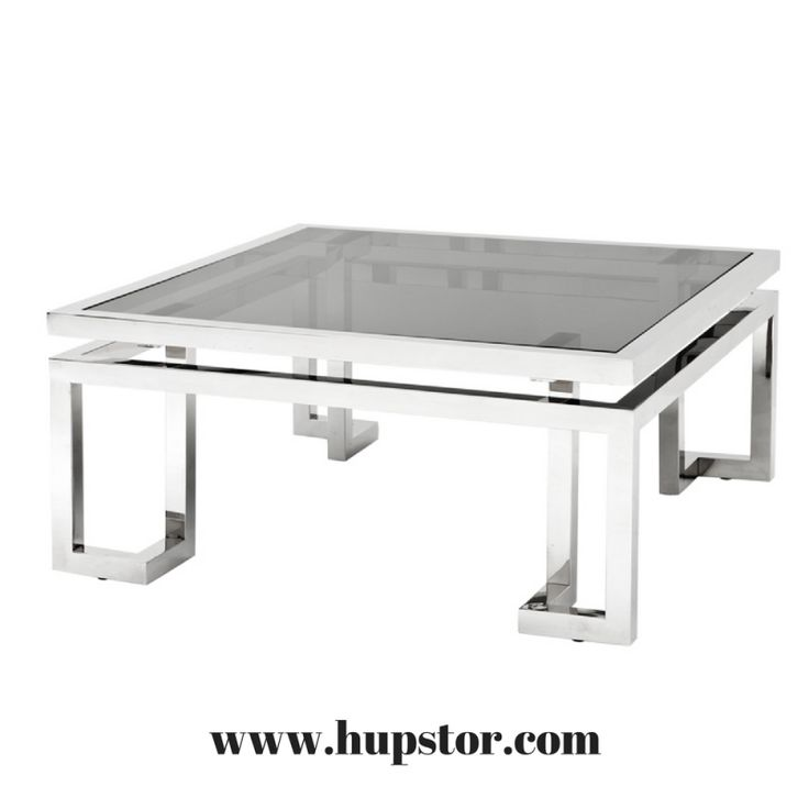 Originalité pour cette table basse Palmer en acier inoxydable finition argent brillante. Elle joue de sa forme carrée pour élever une vitre fumée grise ........