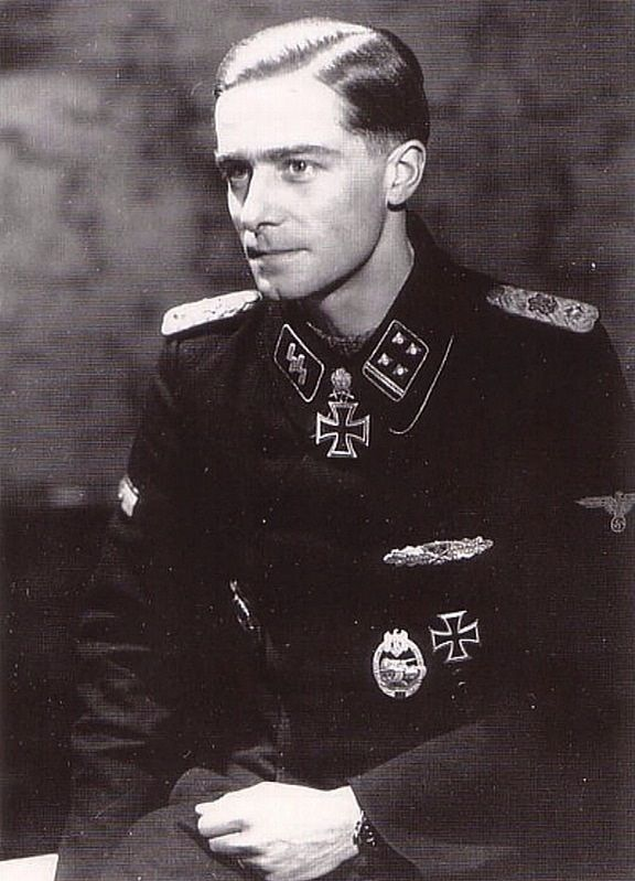 "Waffen SS Standartenführer Joachim Peiper (30 Jan 1915 – 14 Jul 1976) By 1945, youngest SS regt colonel. Convicted war criminal. Murdered France. Knight's Cross on 9 Mar 1943 as SS-Sturmbannführer and commander of the III.(gepanzert)/SS-Pzergrenadier-Regt 2 ""Leibstandarte SS AH""; 377th Oak Leaves on 27 Jan 1944 as SS-Obersturmbannführer and commander of SS-Pzer-Regt 1 ""Leibstandarte SS AH""; 119th Swords on 11 Jan 1945 as SS-Obersturmbannführer and commander of SS-Pzer-Regt 1 ""Leibstandarte…"