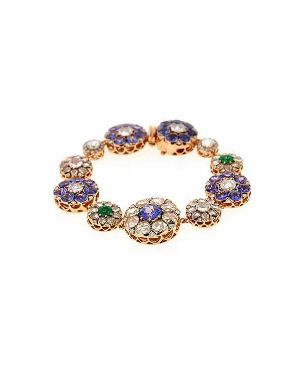 Jewelry designed by Selim Mouzannar: Diamonds bracelet with emeralds and pink gold.
