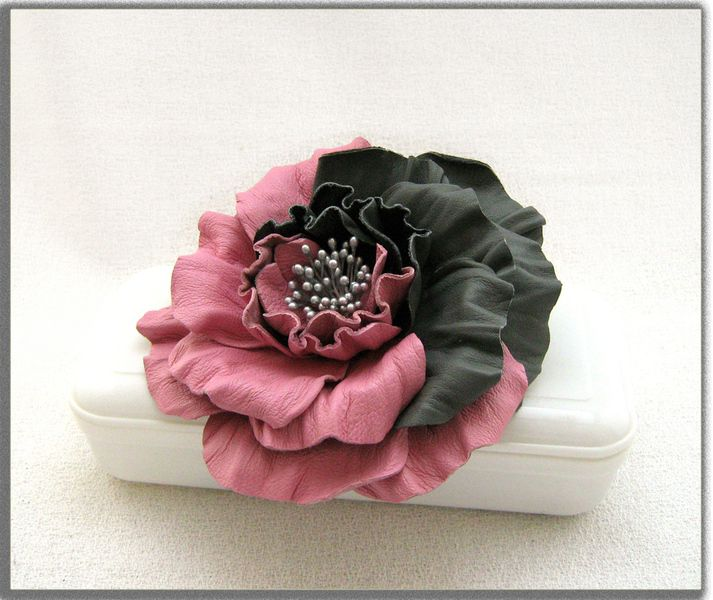 Handcrafted leather rose brooch and hair clips in pink and dark grey. It has been treated to hold its shape.