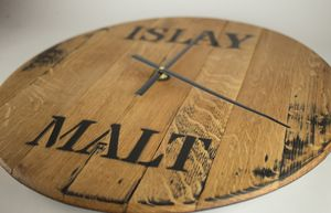 Whisky Cask End Wall Clock  Made from a solid oak genuine Islay Single Malt Whisky cask. Quartz movement Approx 55cms in diameter  Dimensions: (approx) Diameter: 55cm  Material: Oak