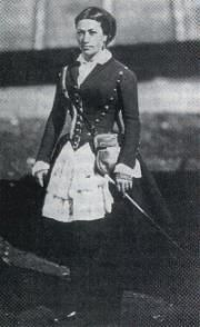 Vivandieres and cantinieres, such as the woman pictured above, had been components of the French military for several centuries. Both vivandieres and cantinieres were attached to specific regiments and held duties that combined the roles of sutler, nurse, cook, and laundress. The only difference between the two titles was that vivandieres were seen on the battlefields following the men, and cantinieres stayed back in the military camps. Military regulations of 1854, however, replaced the…